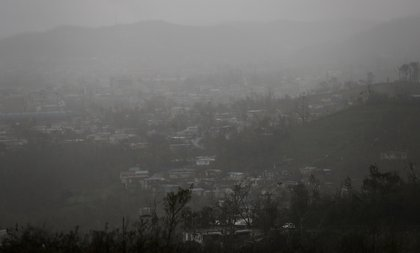 Rain hangs over homes and businesses, three weeks after Hurricane Maria hit the island, on October 11, 2017 in Aibonito, Puerto Rico. <br/>