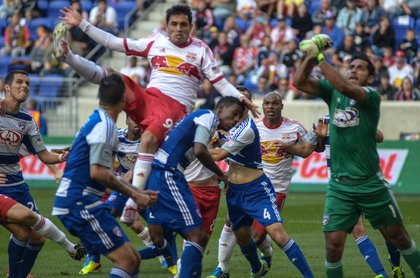 Red Bulls striker Fabian Espindola elevates over several players during second half action.