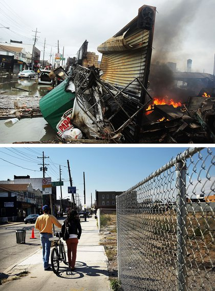 [Top] A fire burns near destroyed homes and businesses following Hurricane Sandy on October 30, 2012 in the Rockaway section of the Queens borough of New York City. [Bottom] Two people walk down a sidewalk past a now empty lot on October 23, 2013
