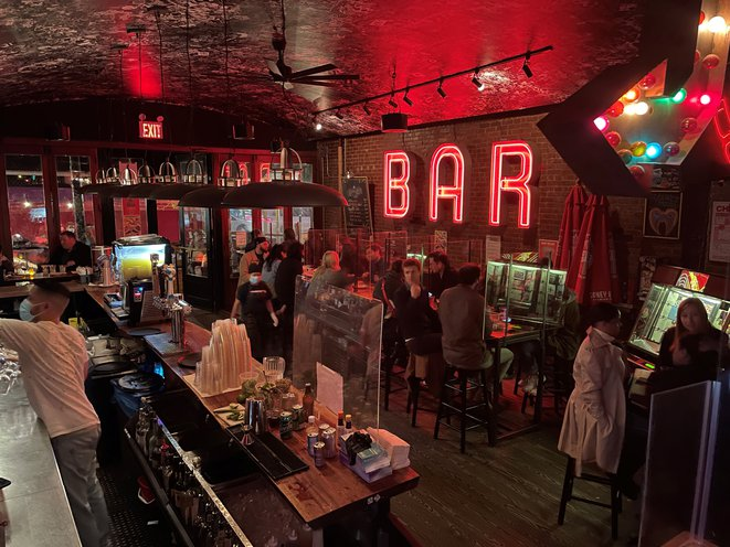 The busy interior of e's Bar on the Upper West Side.