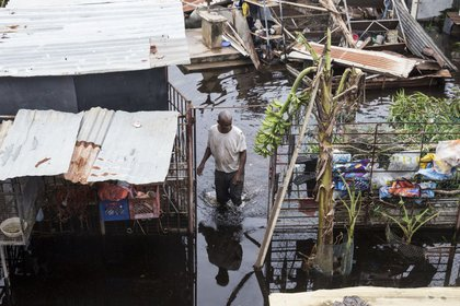A resident wades through flood water days after Hurricane Maria made landfall, on Friday, September 22nd in Loiza, Puerto Rico. (Alex Wroblewski/Getty Images)