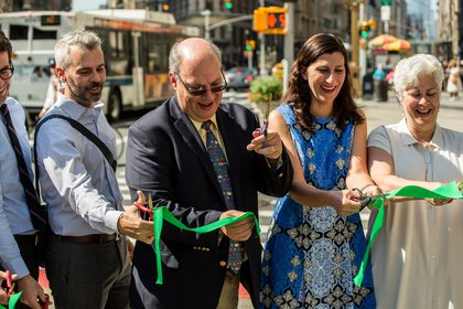 City officials and local business leaders cut a ceremonial ribbon  at the opening of the Shared Streets area.</br>