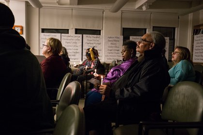 Attendees look on as the names of 143 homeless New Yorkers who died in 2016 are read aloud.<br/>