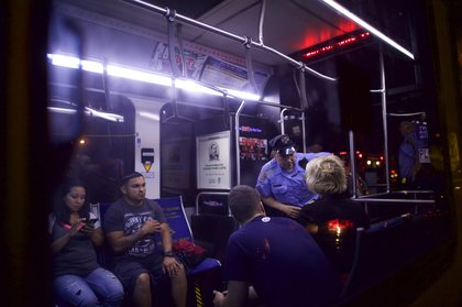 Police officers talk to passengers on a SEPTA train (Getty Images)