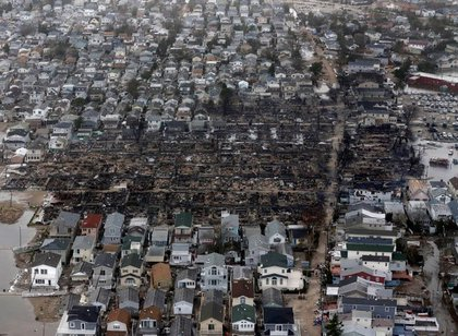 """This is what <a href=""""http://gothamist.com/2012/10/31/photos_the_devastation_of_breezy_po.php"""">Breezy Point looked like</a> (AP)"""