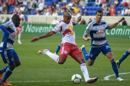Thierry Henry sends a shot goalward in second half action.