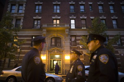 Outside Dr. Spencer's apartment on West 147th Street (AP)