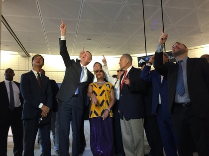 Artist Xenobia Bailey flanked by elected officials<br/>