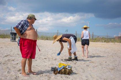 Collecting trash at Rockaway Beach<br>