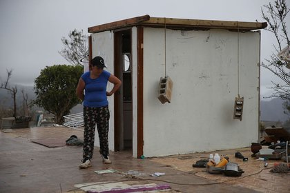 Carmen Maldonado walks near the walls of the bathroom which are the only remaining ones in her home in Hayales de Coamo, Puerto Rico on Sunday, September 24th. (Joe Raedle/Getty Images)
