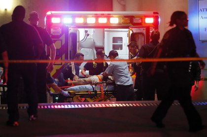 An unknown patient being taken away (Tony Gutierrez/AP)