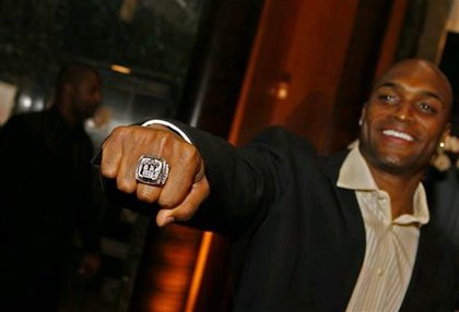 New York Giants wide receiver Amani Toomer shows off his new Super Bowl ring.