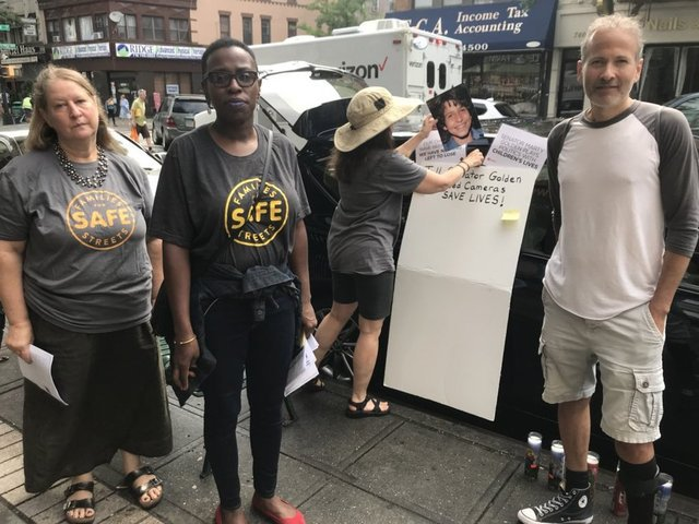 Protesters outside Marty Golden's Bay Ridge office on Thursday