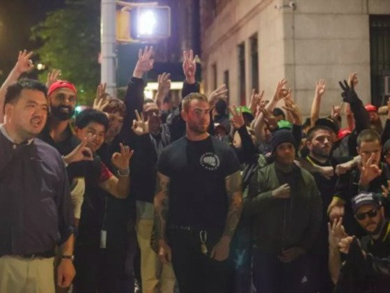 Proud Boys posing for a group photo in the aftermath of their brawl with protesters