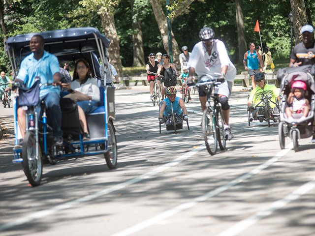 Achilles International holds bi-weekly workouts in Central Park for handcyclists. Cesar Jimenez, left, said riding with a group is crucial, both for safety reasons, and to have someone to chat with. Photo: Skyler Reid