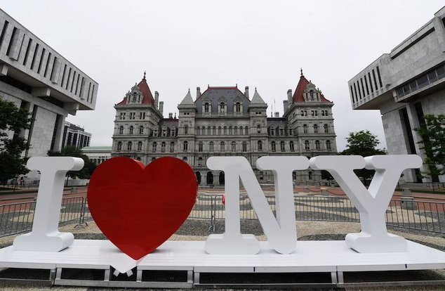 """A new promotional """"I Love NY"""" sign sits in the Empire State Plaza for installation in front of the New York state Capitol in Albany in 2019."""