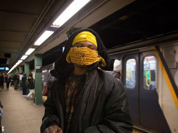 A commuter waiting for one of the noxious gas trains on February 6, 2019
