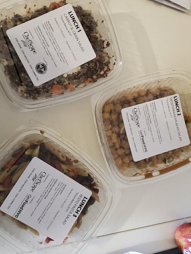 Three packaged salads