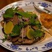 Black pepper beef brisket with pickled radish and black pepper butter toast(Sam Horine/ Gothamist)