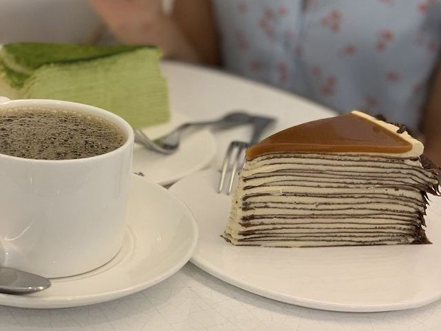 This is a picture of two slices of cake from Lady M Confections in New York City.