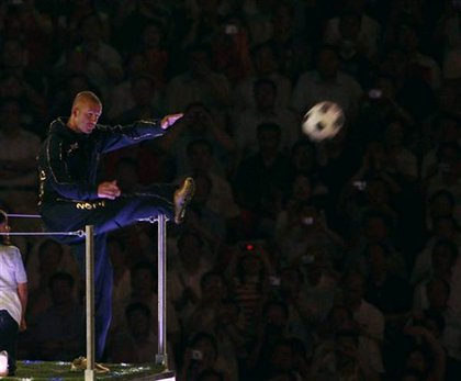 Also in the bus: David Beckham, who kicked a soccer ball into the crowd.