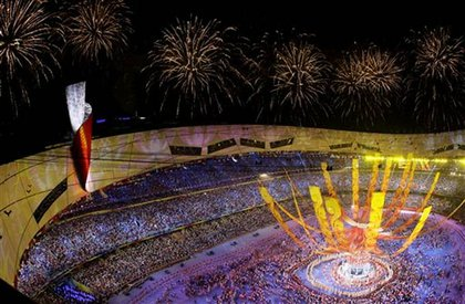 A finale of performers and fireworks, with the torch cauldron.