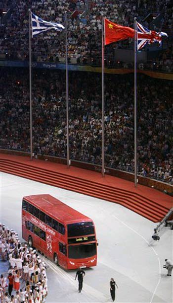A double-decker bus comes into the National Stadium, signaling the 2012 Olympics in London.