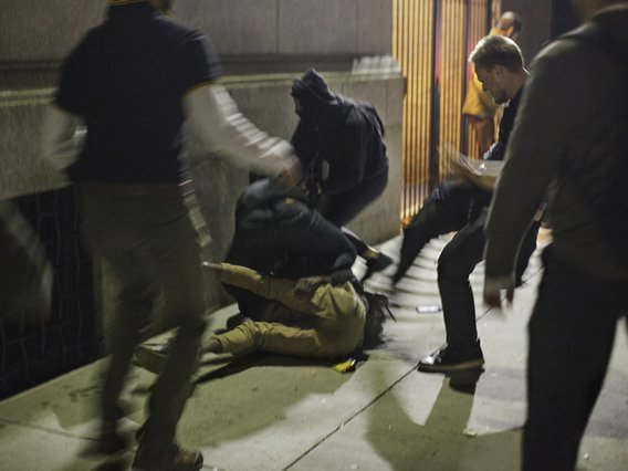 A Proud Boy kicking a protester outside the Metropolitan Republican Club on Friday night