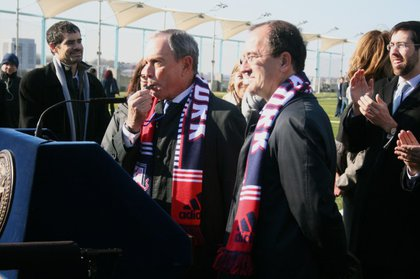 Bloomberg, alongside Red Bulls general manager Jérôme de Bontin, blows the whistle to officially open the fields.