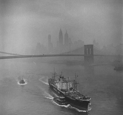 """November 12th, 1953. """"Downtown New York dimly seen through smog mist hovering over the river where the Yamashita Line ship is coasting towards the bridge."""""""