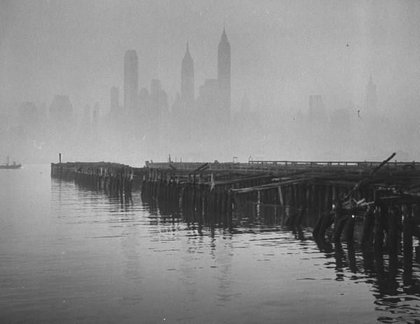 """November 21st, 1953.""""Downtown New York dimly seen through smog mist hovering over the river where the rickety pier is in the foreground."""""""