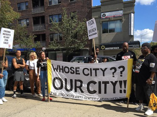 Protesters rally outside of the Ebbets Field apartments.