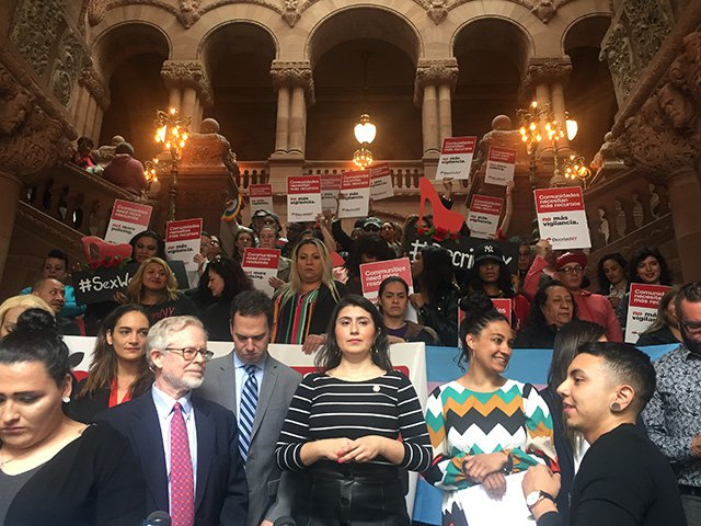 Sen. Julia Salazar, Assemb. Richard Gottfried, Assemblymember Dan Quart, Senator Jessica Ramos, and Jessica Raven of Decrim NY pose with demonstrators at the state capitol in Albany on Tuesday.