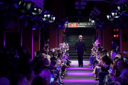Tom Ford greets onlookers at the Spring Summer 2020 fashion show at the Bowery station.