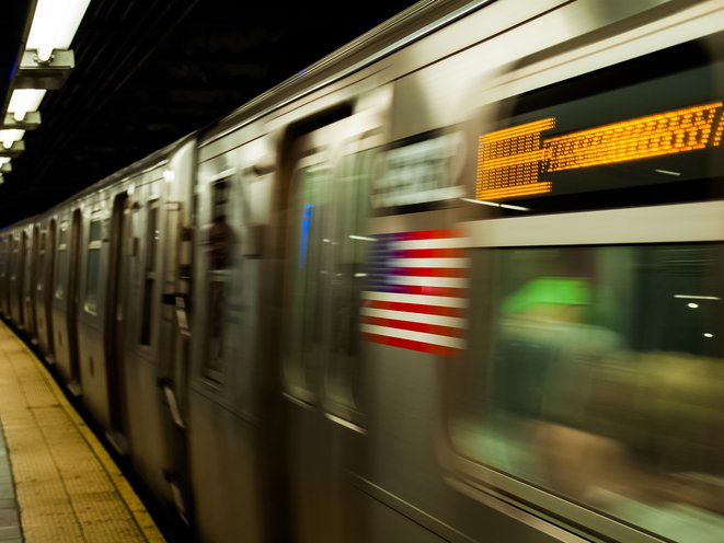 An E train in motion, with the photo blurred.
