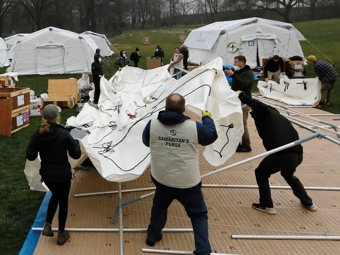 Volunteers with Samaritan's Purse erect a makeshift hospital in the East Meadow of Central Park on Sunday