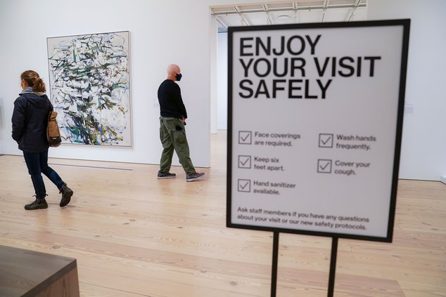 Patrons wear protective masks and maintain social distancing as they browse the galleries at the Whitney Museum of American Art.