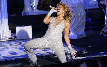 Jennifer Lopez ina white sequined jumpsuit