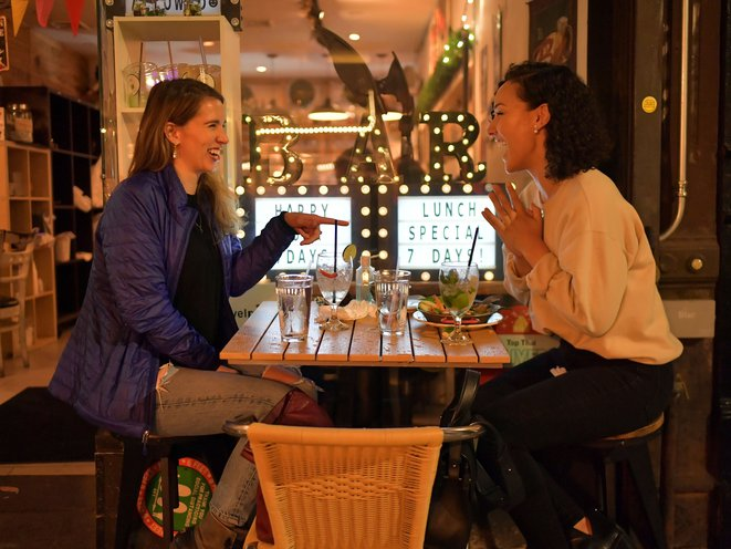 A photo of NYers Erika Rothschild and Alysha Webb enjoy an evening out in Greenwich Village