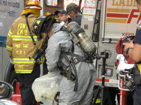 A firefighter in a hazmat suit on 61st Street this morning