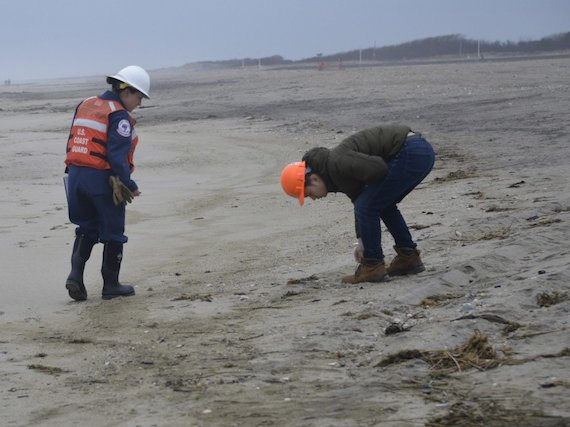 Coast Guard Petty Officer NiChelle Flynn and New York Department of Environmental Conservation environmental engineer Rick Lin patrol Breezy Point Beach Sunday, March 31, 2019, searching for tar balls.