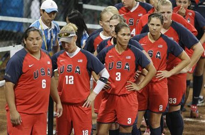 The U.S. women's softball team is dejected after a loss to Japan.
