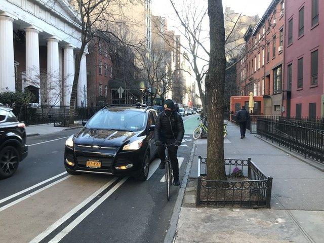 The new bike lane on 13th Street betwen 6th & 7th Avenues