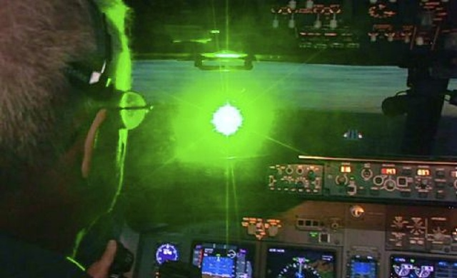 A video still from the FBI shows the blinding effect of laser pointers in cockpits.