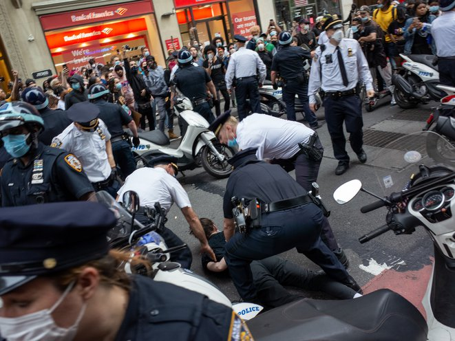 Officers arrest a protester at a George Floyd protest.