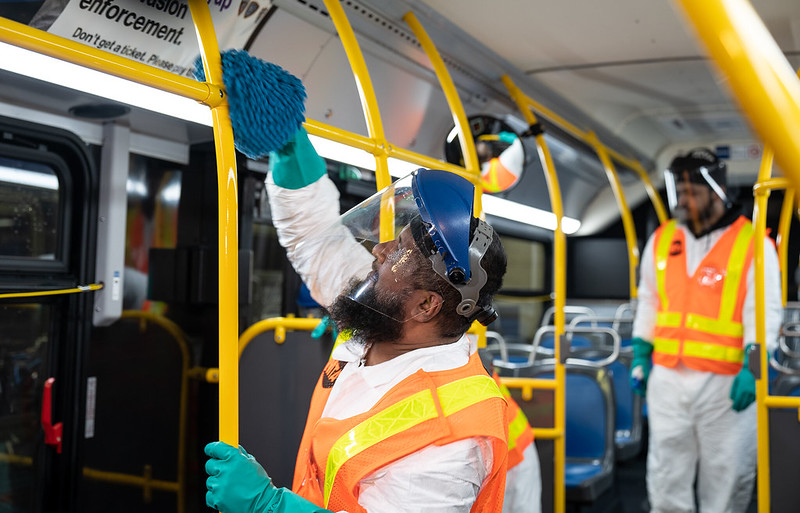 MTA workers disinfect a bus in March.