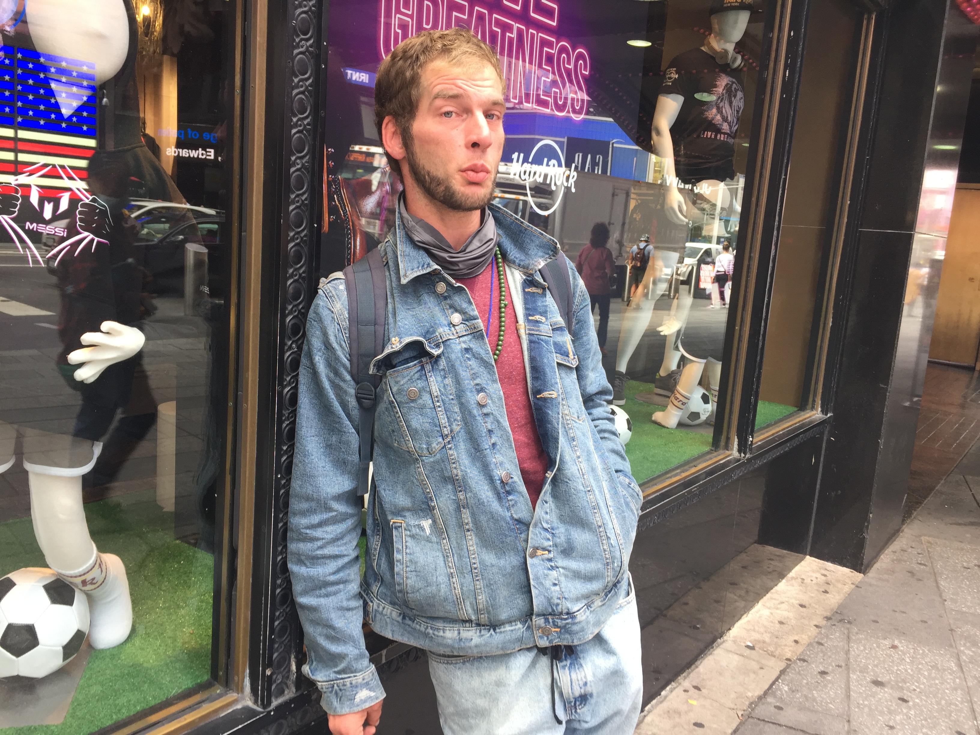 Benjamin, a white man wearing a denim jacket, outside a store