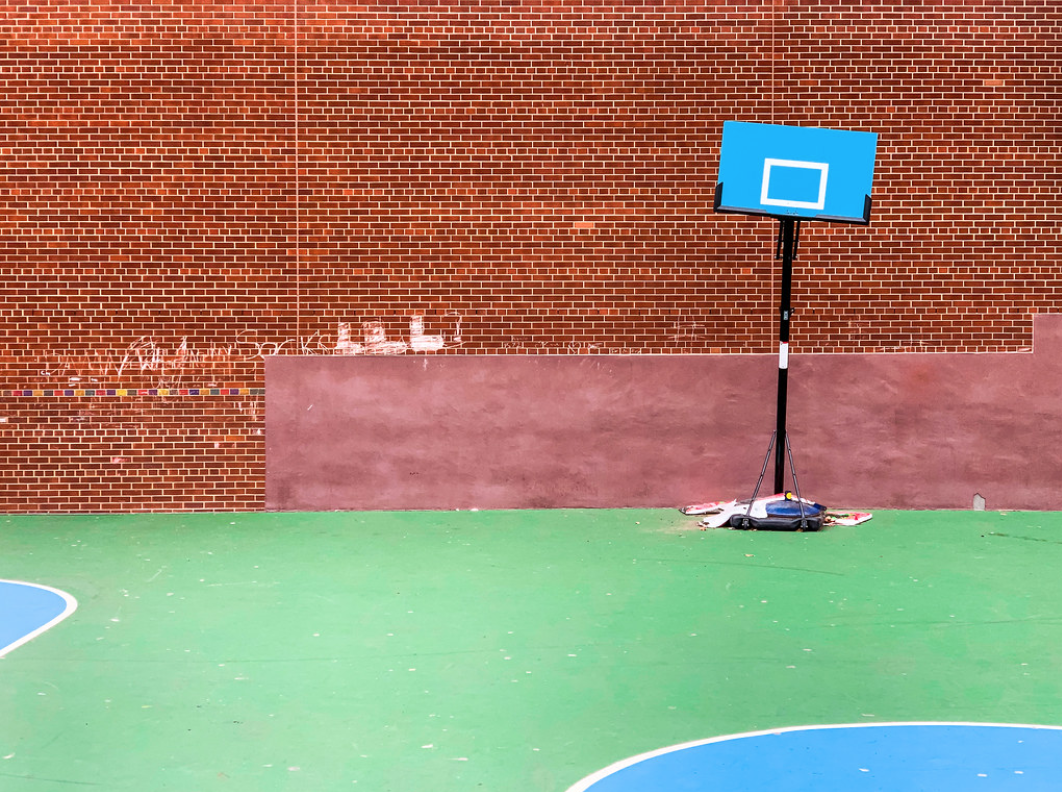 A photo of a basketball hoop taped to the ground