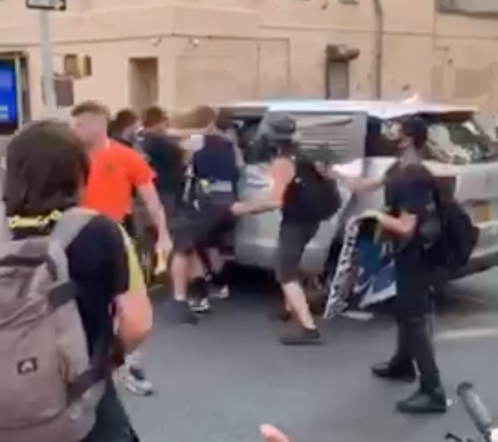 Video shows NYPD officers throwing a protester into an unmarked van on Tuesday night