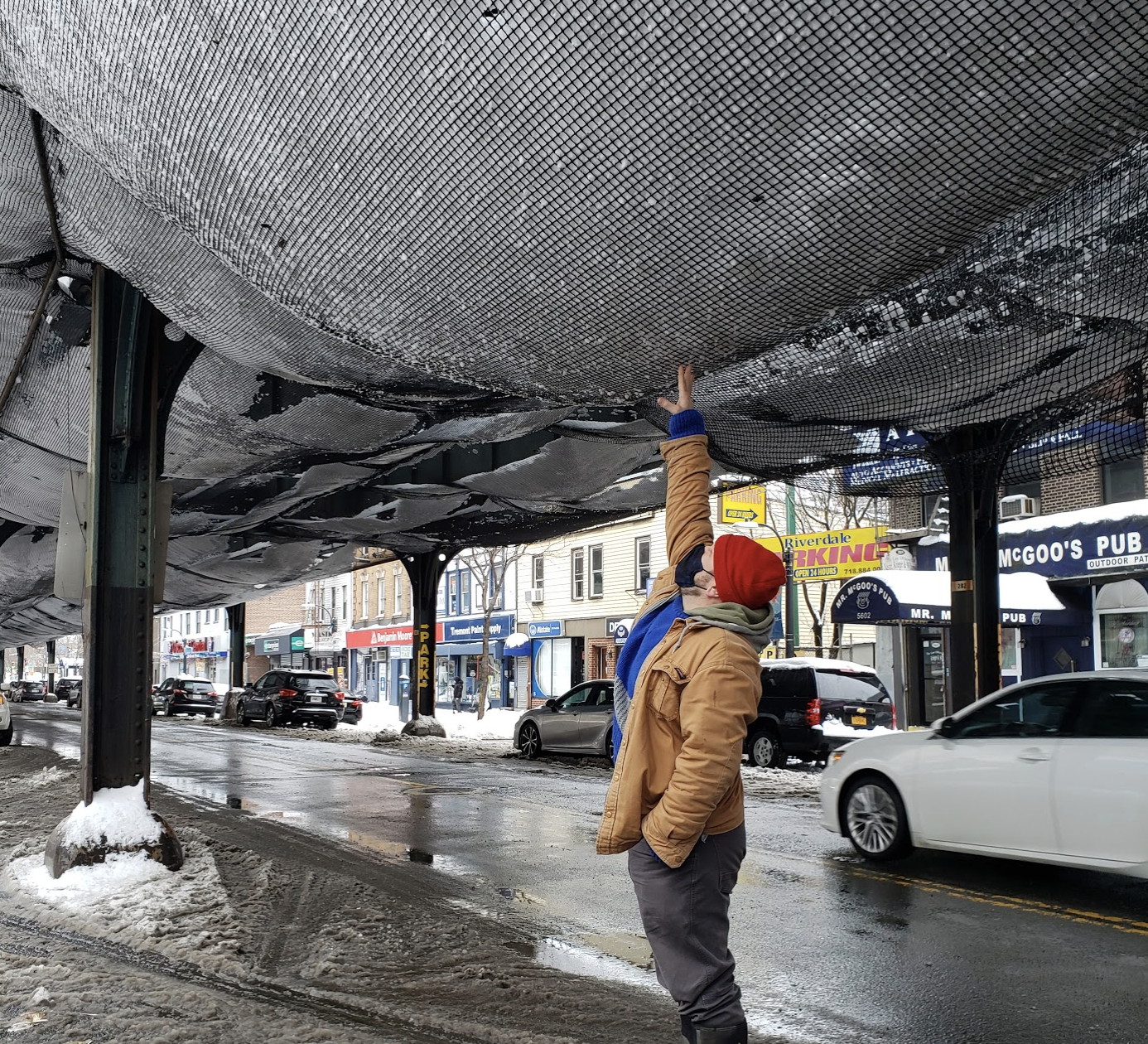 Carl Mehling, standing under the snow-filled net in the Bronx